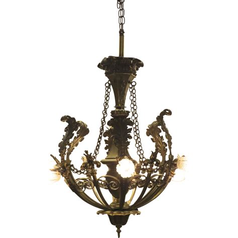 bronze six arm chandelier with acanthus leaf and fleur de