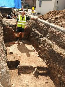 Archaeologists digging under a council car park in ...