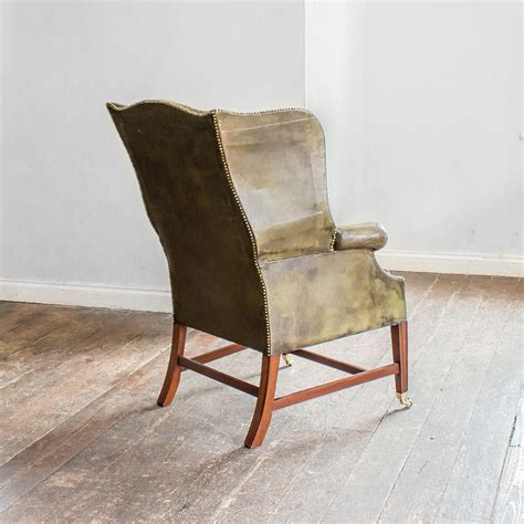 Green Leather Armchair by A Mahogany And Green Leather Wing Armchair