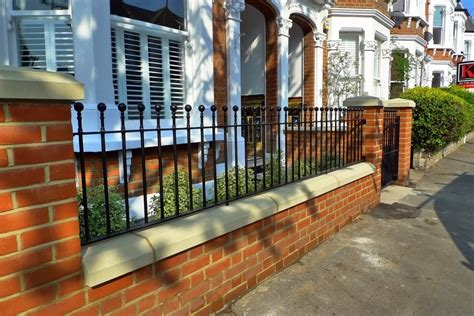 front garden wall designs clapham balham victorian mosaic tile path black and white red brick wall metal wrought iron rail