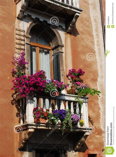 window  balcony  flowers stock photo image