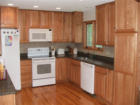 pantry style kitchen cabinets french country kitchen style featuring cherry cabinet in