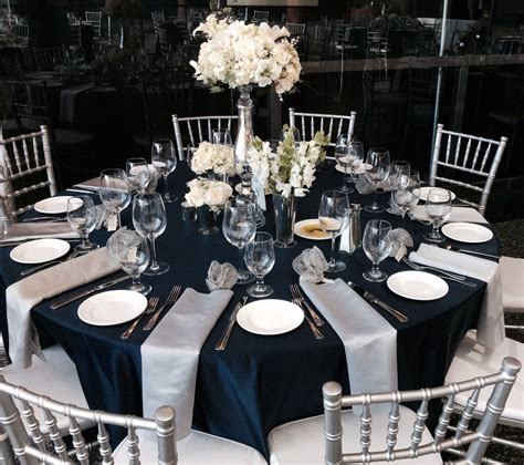 wedding reception guest table flower centerpieces navy