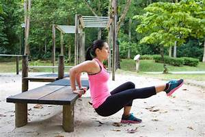 Woman Doing Dips On Right Leg In Outdoor Exercise Park ...