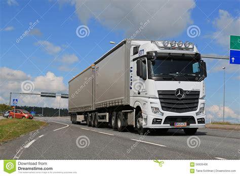 mercedes truck white white mercedes benz actros truck trailer in traffic