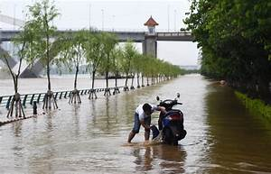 Death toll in China's latest round of flooding reaches 52 ...