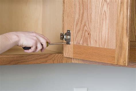 how to remove kitchen cabinets from floor get the look of new kitchen cabinets the easy way