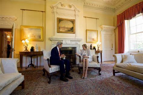 secretary kerry sits  british prime minister