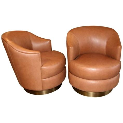 a rudin leather swivel chairs with brass base ordered by st