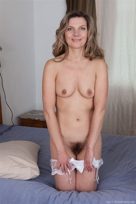 aga strips naked while laying in bed
