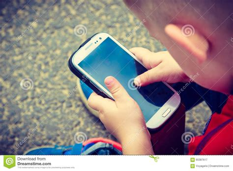 Little Boy Child Playing Mobile Games On Smartphone Stock