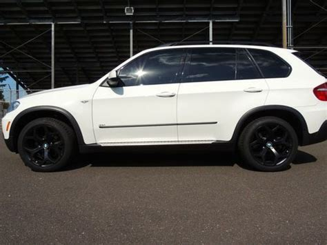 find  bmw    immaculate white  mls nav