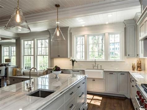 white macaubas quartzite countertops white cabinets