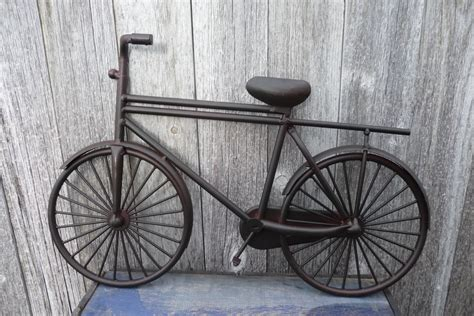 It's very simple and very intuitive. Metal Bicycle Bike Art Wall Art Retro Decor Decoration