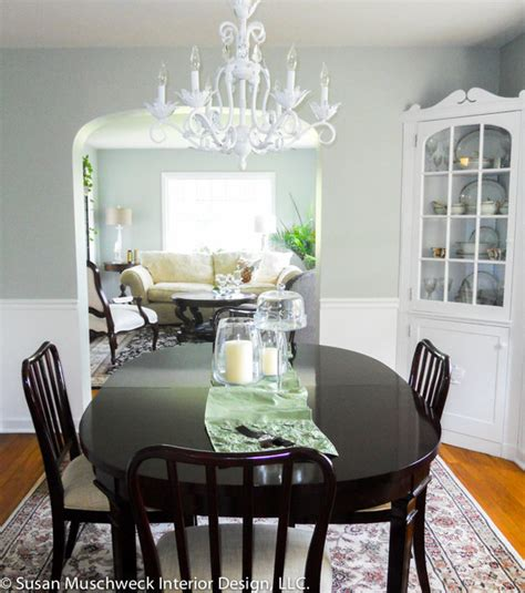 traditional dining room with white chandelier and