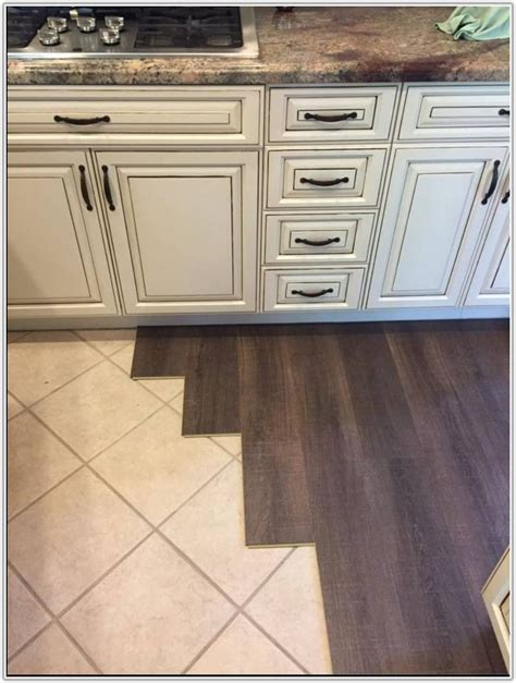 laying laminate flooring on wooden floorboards installing laminate wood flooring over tile flooring home decorating ideas klxbllb2w9