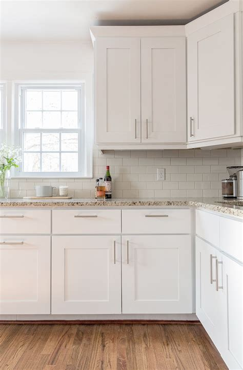 A Simple Kitchen Update  Painting Dark Cabinets Color
