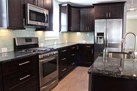 black glass tiles for kitchen backsplashes tips on choosing the tile for your kitchen backsplash midcityeast