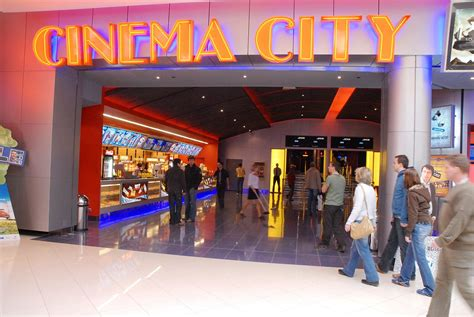 The Entrance Of A Cinema Hotel Or Theatre by Cinema City Prague Stay