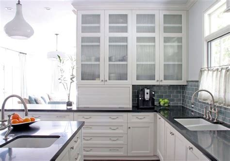 white kitchen cabinets with glass doors glass front cabinets white kitchen counters