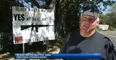 black rifles matter sign  maine tourist town draws