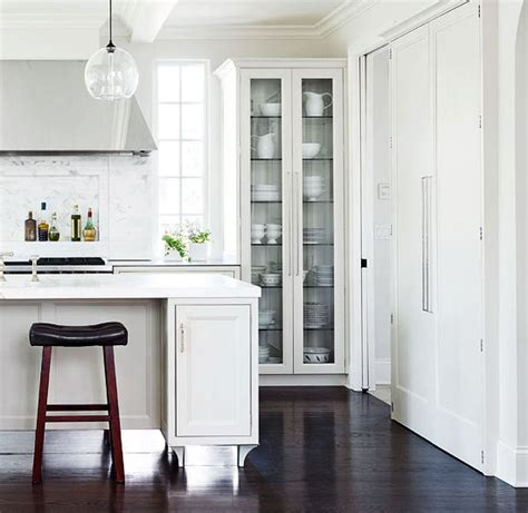 tall glass front cabinet floor to ceiling glass cabinets traditional kitchen