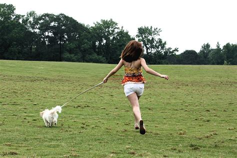 dog girl  stock photo  cute young girl running