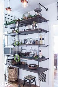 Tips for making a diy industrial pipe shelving unit diy for Kitchen cabinets lowes with make your own wall art canvas