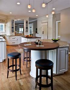 Traditional kitchen- round wood top on island end; tall