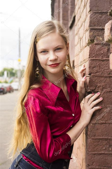 young female teen girl pose   brick wall stock
