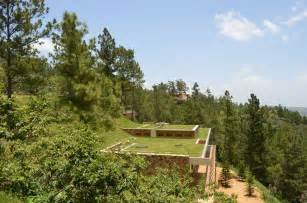 homes built into hillside grass roofed home built into slope uses hillside for