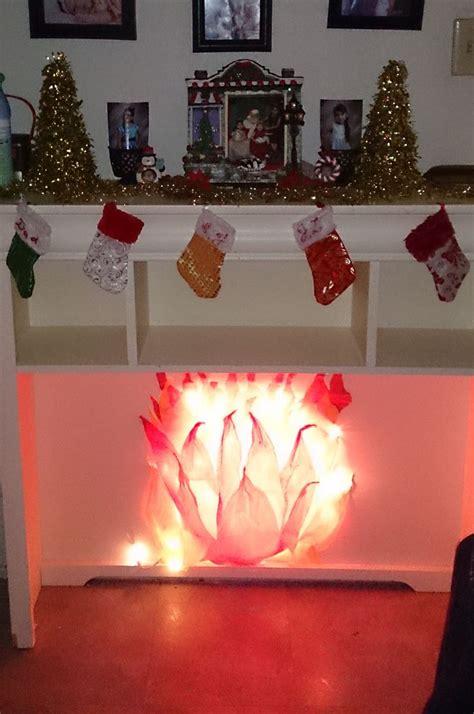 diy fake fireplace   tissue paper   string