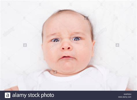 Scared Crying Baby Alone In His Crib Stock Photo