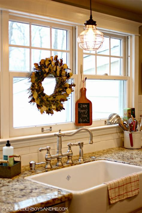 over the sink light fixture golden boys and me winter in our kitchen