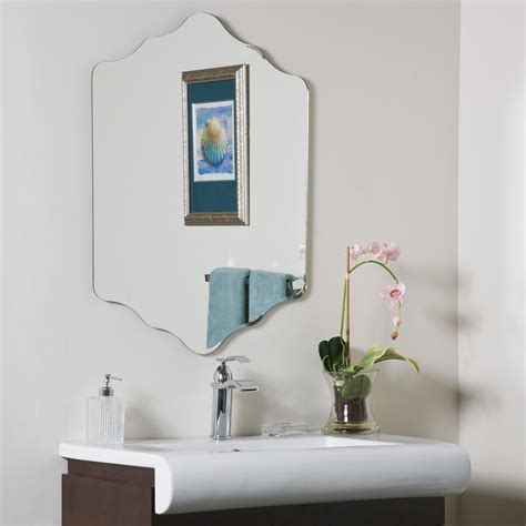 Give your bathroom a modern new look withgive your bathroom a modern new look with the roland frameless wall mirror featuring a beautiful rounded look and shelf for your toiletries. Decor Wonderland Vandam Frameless Wall Mirror & Reviews   Wayfair