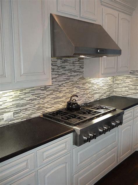 Black Countertop Backsplash - black pearl leather granite countertops with a mosaic