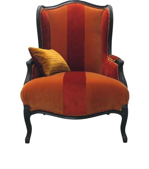 and orange velvet wingback chair