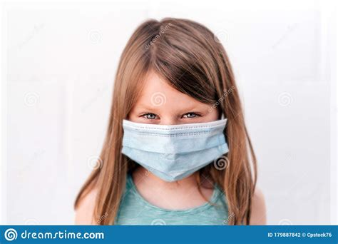 Portrait Of A Girl Wearing An Antivirus Mask Against ...
