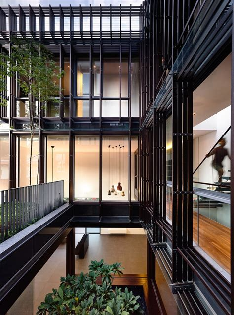 open tropical home  interior courtyard  wood features