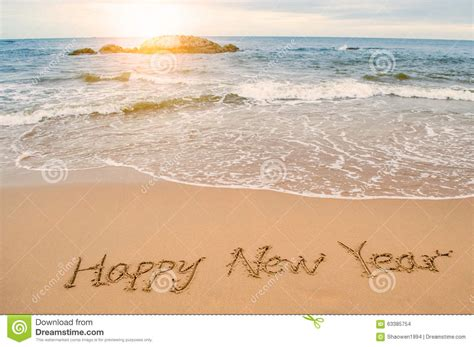 Write Happy New Year On Beach Stock Photo