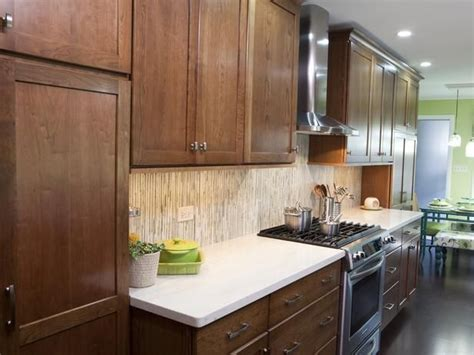 brown kitchen cabinets with white countertops warm brown cabinets are paired with clean white 156 | 2c07694a34c084657995baa458451530