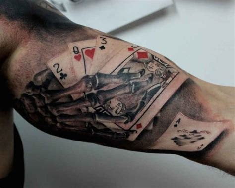 upper arm tattoo playing cards skelet http