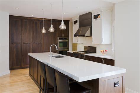 Dark Brown Wooden Kitchen Cabinets And Island Having White