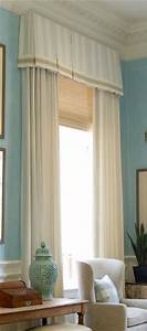 Good example of layering the roman shade undertreatment for Curtains that look like roman shades