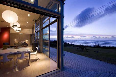 waitara bach  zealand beach property home  architect