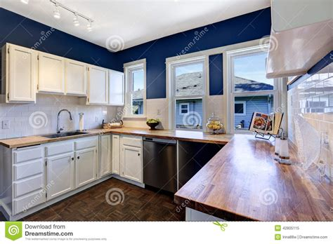 kitchen island seats 6 kitchen interior in bright navy and white colors stock
