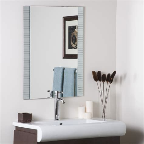 Constructed of metal and strong 3/16 glass, this mirror features a border of metal encased in glass created with a fine, precise manufacturing. Decor Wonderland Sam Frameless Wall Mirror & Reviews   Wayfair