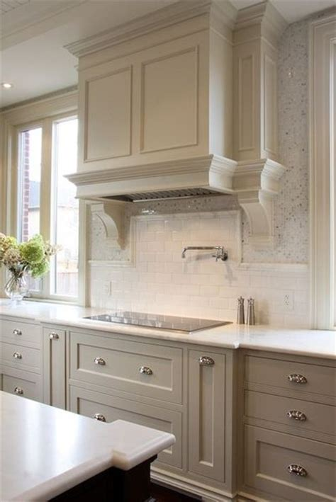 light gray kitchen cabinets with honed marble countertops