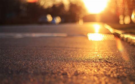 close  land asphalt sun rays bokeh blur background