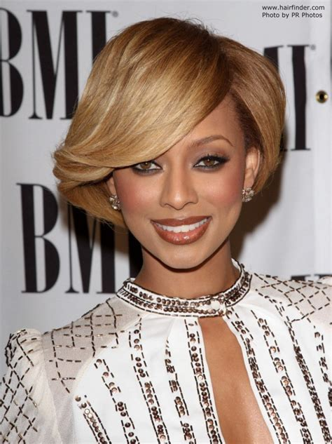 Keri Hilson sporting a short and glossy capped hairstyle